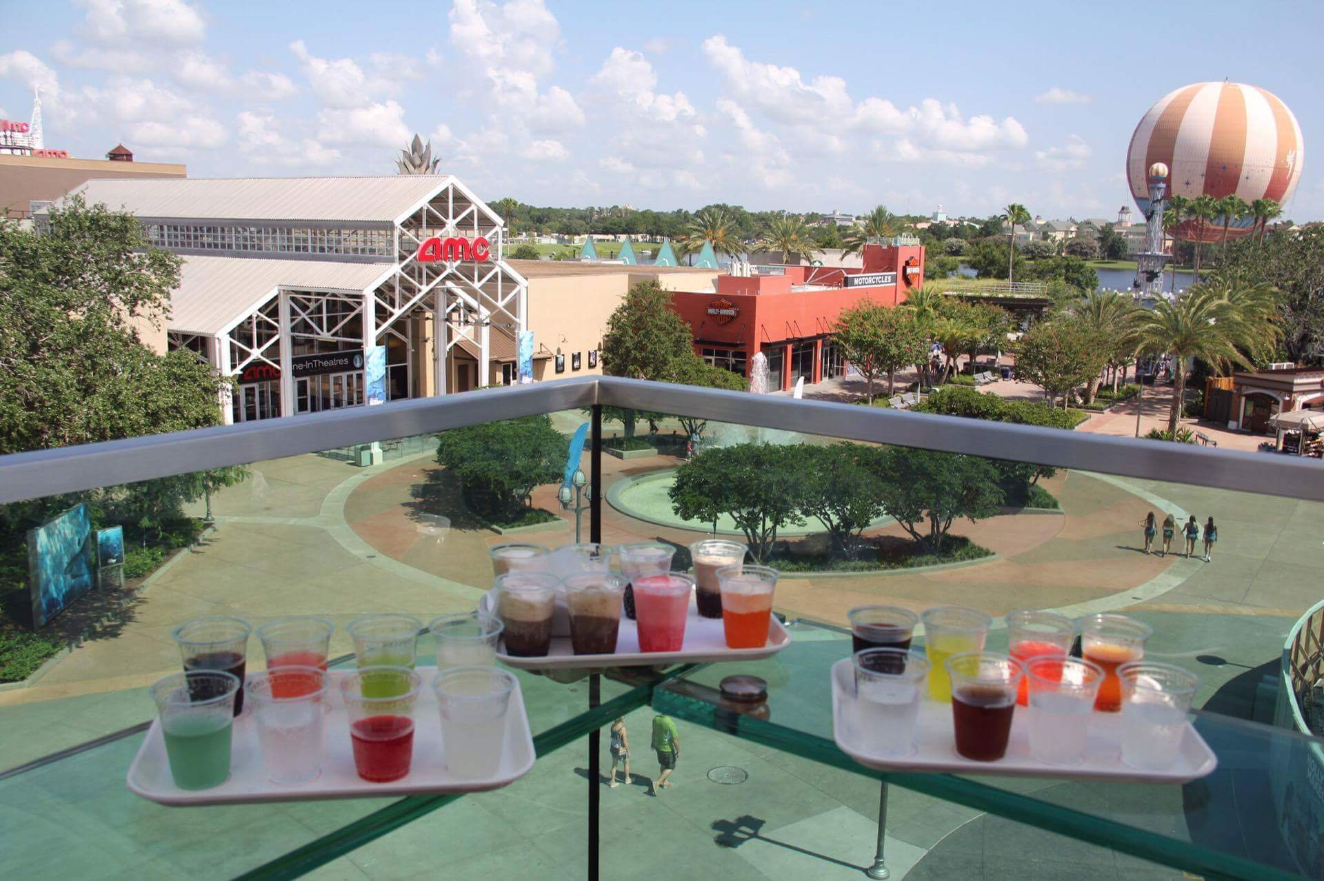 View from the rooftop bar at Coca-Cola Store during the daytime. On table at the rooftop bar features an array of drinks from the sampling special.