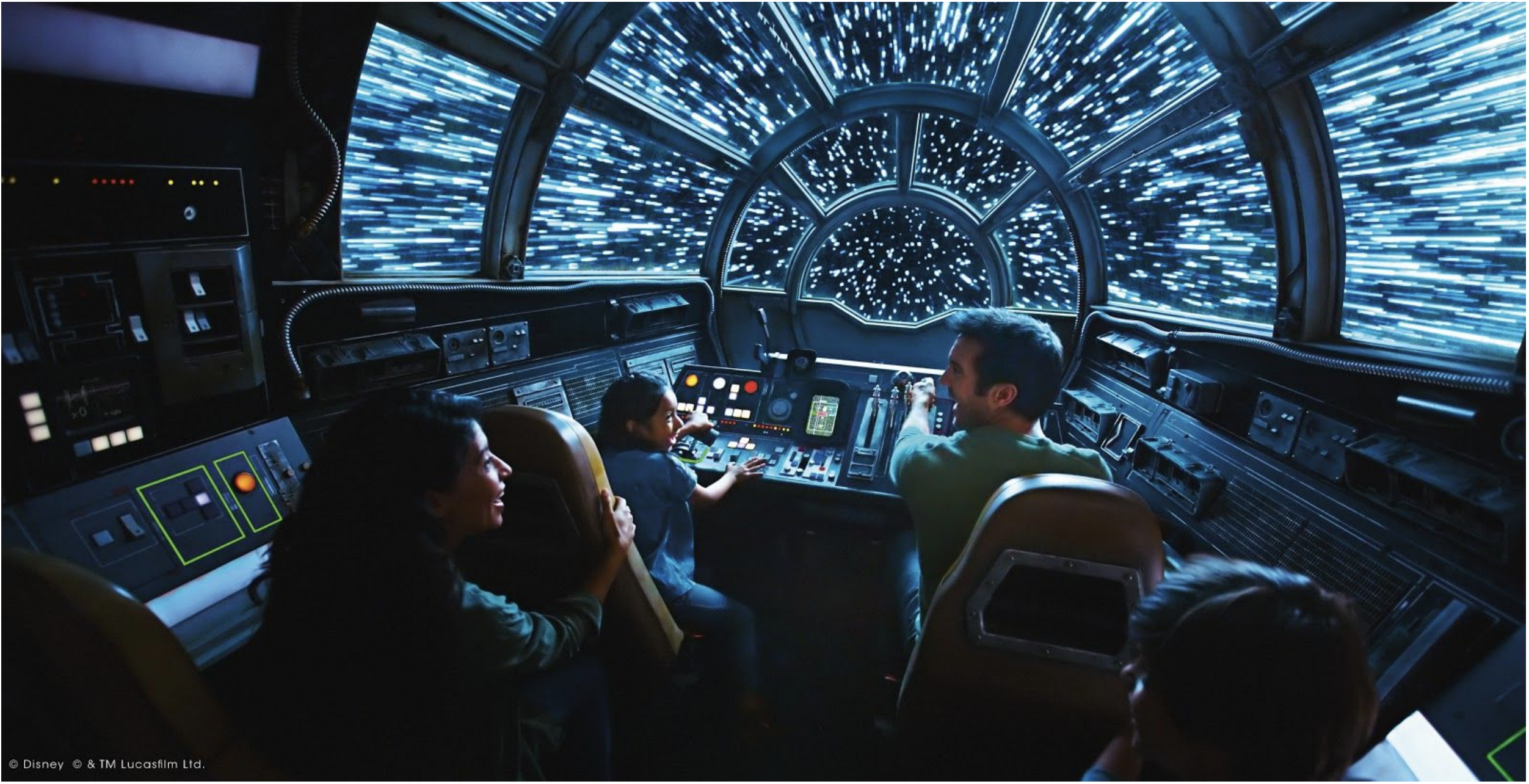 Four guests on simulated Millenium Falcon: Smugglers Run where they are seen to be zooming through space and stars with blue hue casted over the photo. Preview for Star Wars: Galaxy's Edge at Disney's Hollywood Studios.