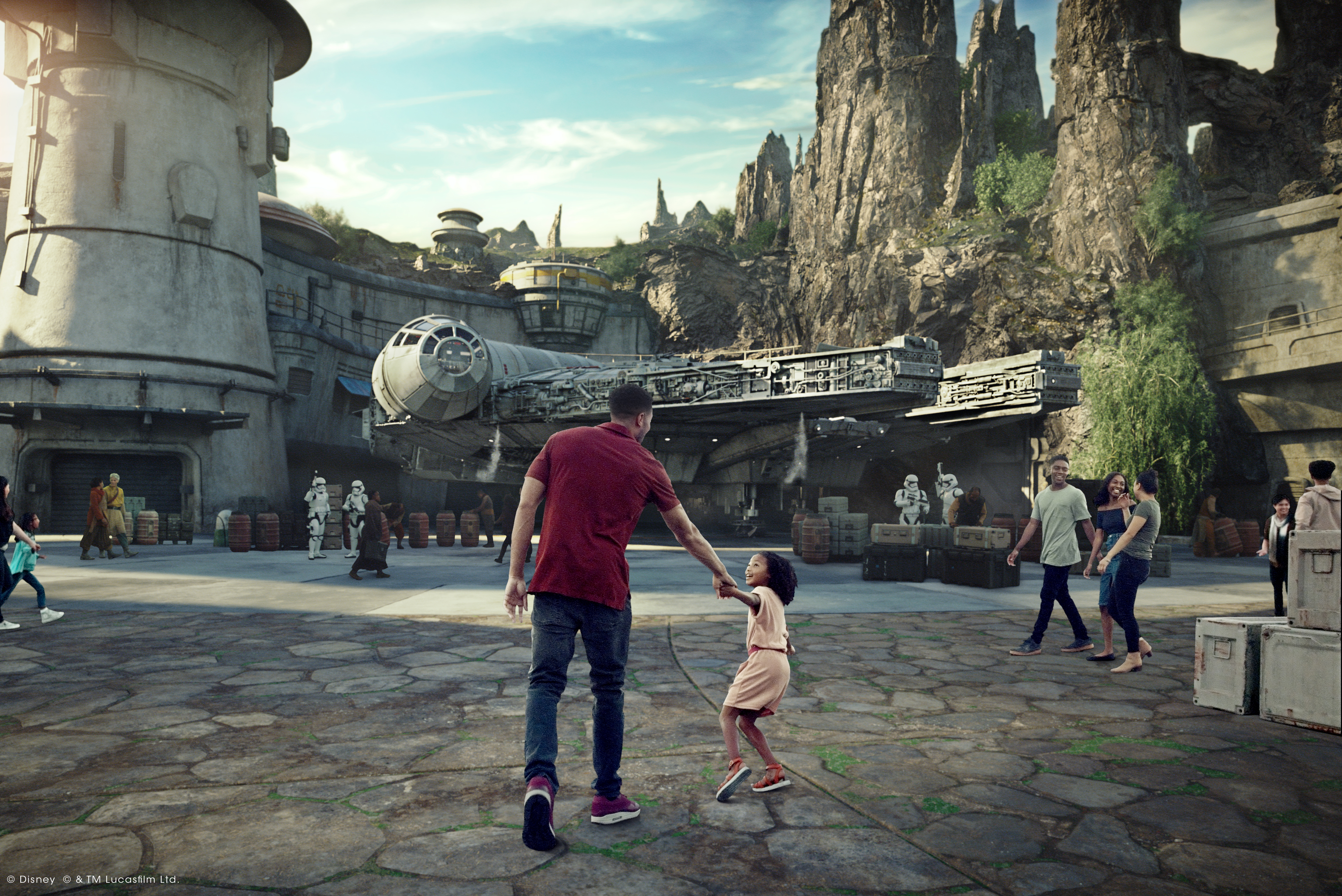 Daughter pulls father's hand as they travel through Batuu for Star Wars: Galaxy's Edge at Disney's Hollywood Studios